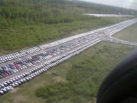 On suburbs of Saint-Petersburg thousands of new foreign cars are rusting
